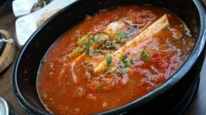 The best Kimchi Jjigae I have had is found in my current town, Gyeryong. I always give the huge slab of tofu to Adam, though.  Pic by: Div